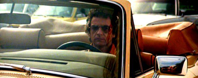 Dudley Moore als George Webber am Steuer seiner Limousine