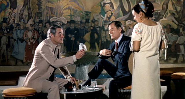 Robert Webber und Gig Young als zwei Kopfgeldjäger in einem mexikanischen Restaurant