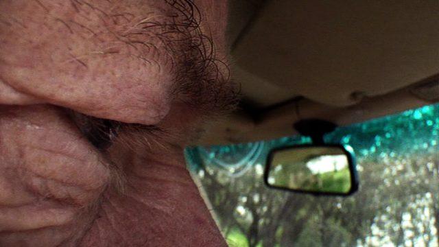 Nahaufname von Richie Becketts (Peter Mullan) Gesicht während der Fahrt in seinem Mercedes SL, Copyright: World Productions