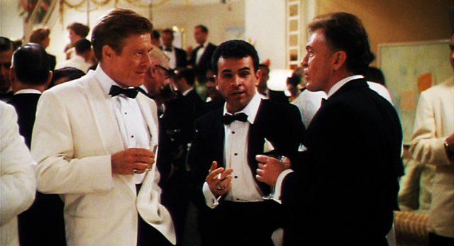 Jack Weil (Robert Redford) im Gespräch mit zwei Männern auf einer Party
