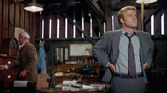 Owen Legate (Robert Redford) im Büro einer Filiale der Bahngesellschaft