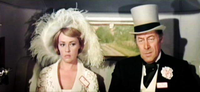 Lady Eloise Frinton (Jeanne Moreau) und Lord Charles Frinton (Rex Harrison) im Fond ihres Rolls-Royce