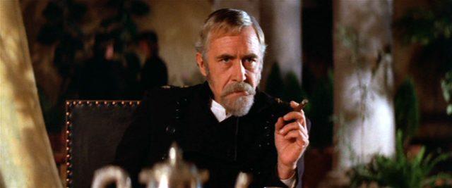 Jason Robards als Gouverneur Lew Wallace am Tisch mit Zigarre