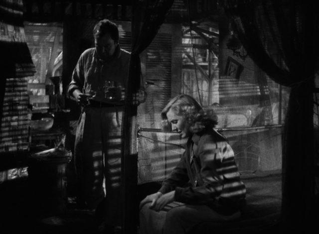 Kid und Bonnie in einem dunklen Raum mit viel Schattenspiel.