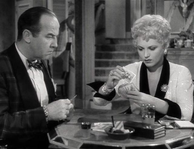 Harry und Billie ohne fröhliche Gesichter beim gemeinsamen Kartenspiel.